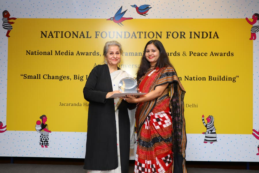 Dr Syeda Hameed with one of NFI's media awardees