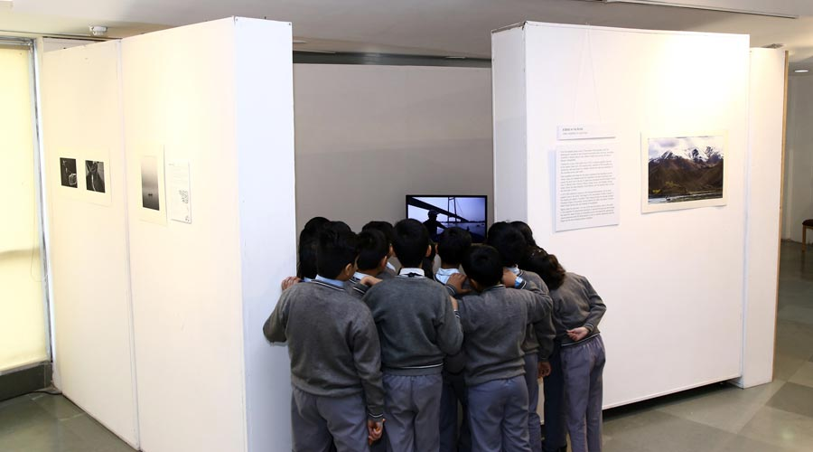 Curious school children watch a visual of the River Brahmaputra